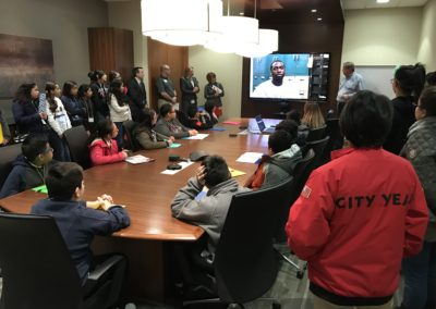 Students gather in Creative Business Interiors Boardroom